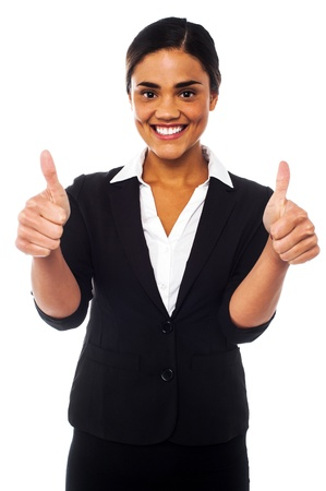 yup: Young businesswoman showing double thumbs up to the camera