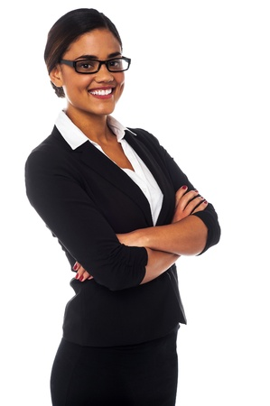 gorgeous businesswoman: Smiling young business professional posing arms crossed Stock Photo