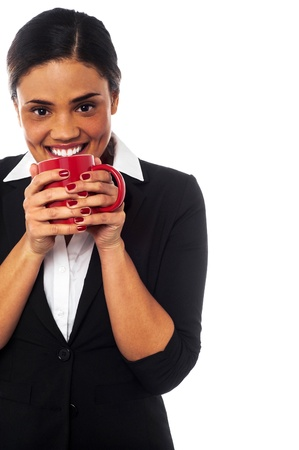 Young businesswoman enjoying coffee during her work break photo