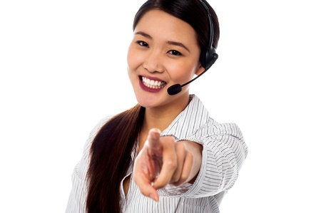 Female call center executive pointing at you over white Stock Photo - 20195505
