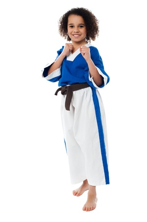 Little girl kung fu expert is ready for some action. Are you? photo