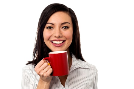 Young female corporate enjoying coffee during her work break photo
