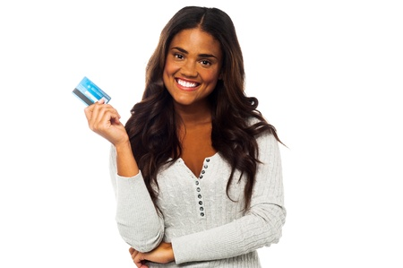Pretty charming woman holding up a credit card over white Stock Photo