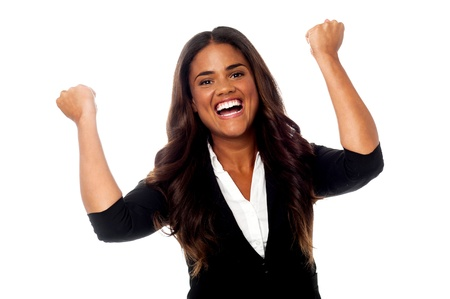 clenching: Businesswoman clenching her fists in excitement Stock Photo