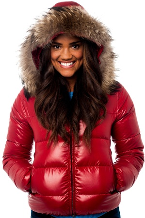 Smiling young african girl wearing winter hood jacket photo