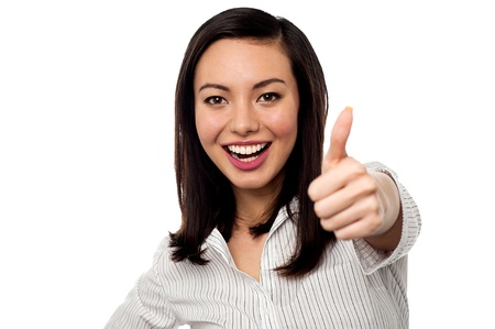 Smiling Asian corporate woman gesturing thumbs up Stock Photo - 20465128