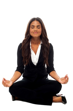 formals: Corporate lady practicing meditation in lotus pose