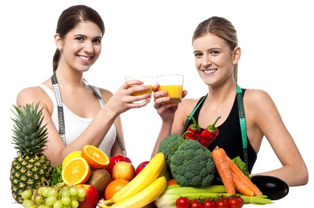 Fit and healthy caucasian models enjoying glass of juice each photo