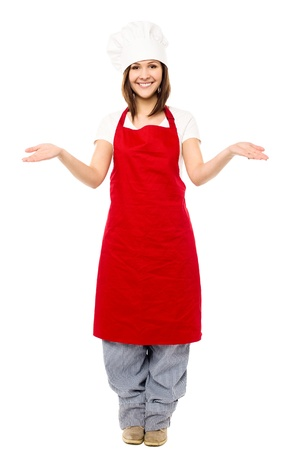 Full length image of charming young female chef photo
