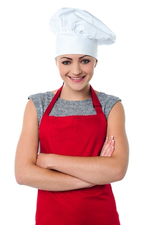 toque: Gorgeous young female baker wearing white toque Stock Photo
