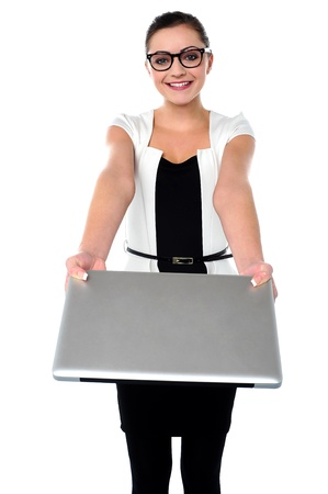 arms  outstretched: Pretty girl with laptop in her outstretched arms