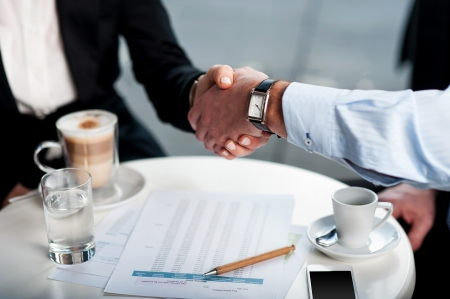 technology deal: Two business tycoons meet over a coffee and closed long-term deal Stock Photo