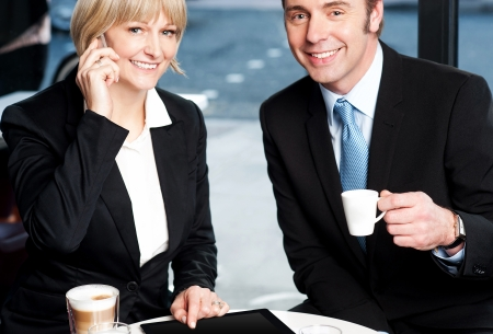 Business colleagues enjoying coffee and discussing business photo