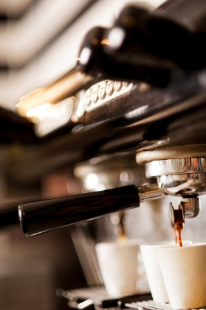 coffee machine: Process of preparation of coffee, a closeup Stock Photo