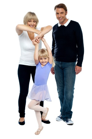 Young parents helping their daughter dance photo