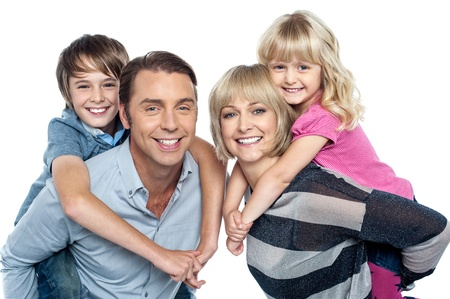 Portrait of friendly family of four in the studio photo