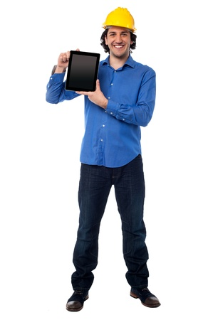 Handsome architect showing brand new tablet device photo