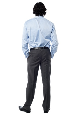 Rear view of a casual businessman, full length shot photo