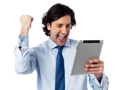 Business executive holding touch pad. Full of enthusiasm. photo