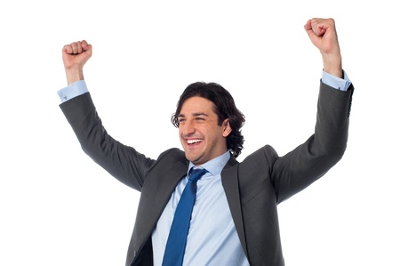 clenching: Successful businessman clenching his fists in excitement Stock Photo