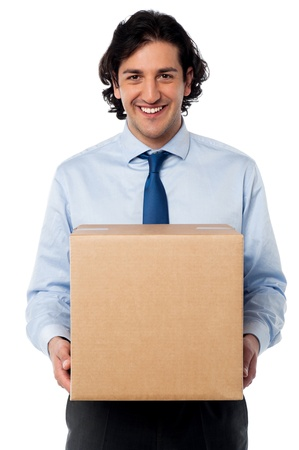 carrying box: Young professional carrying heavy carton Stock Photo
