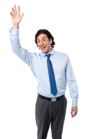 Excited young businessman in action photo