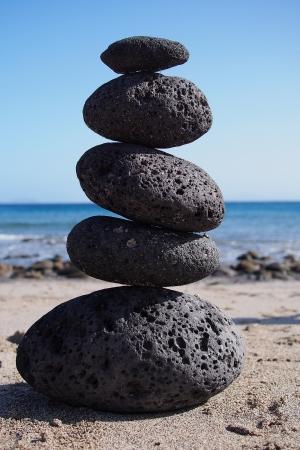 Zen stones tower near coastline photo