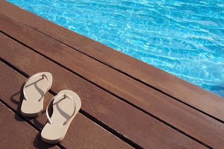 Mens flip-flops by the swimming pool