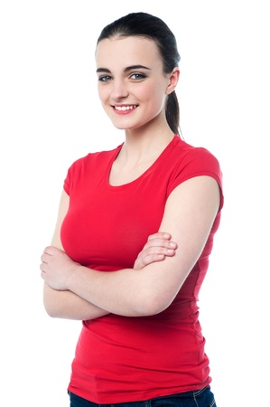 casuals: Cheerful pretty girl in casuals posing with folded arms
