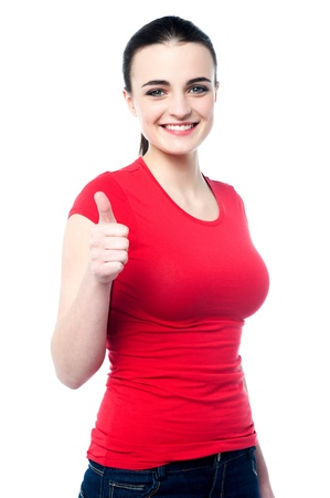 yup: Young caucasian girl showing thumbs up