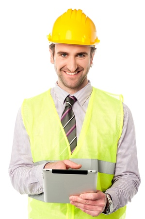 Young mechanical engineer using tablet pc Stock Photo