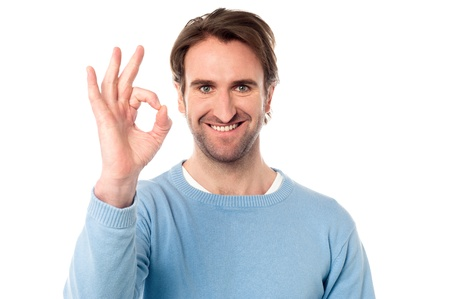 yup: Handsome young man showing OK sign over white Stock Photo