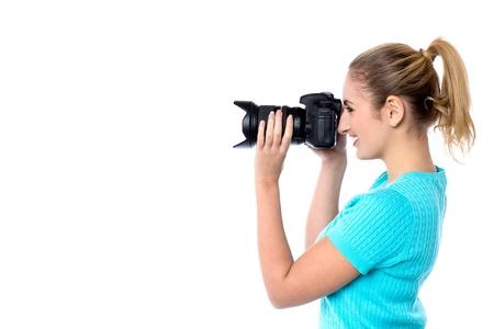 capture the moment: Female photographer focusing to capture the moment Stock Photo