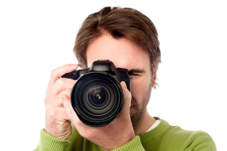 Man with digital SLR camera isolated over white photo