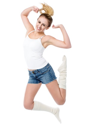 armpits: Beautiful girl jumping high in the air with joy Stock Photo