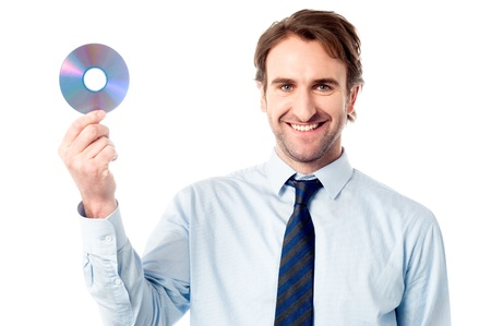 Smart executive holding a compact disc photo