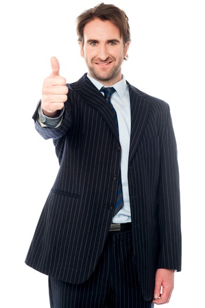 Isolated male manager gesturing thumbs up
