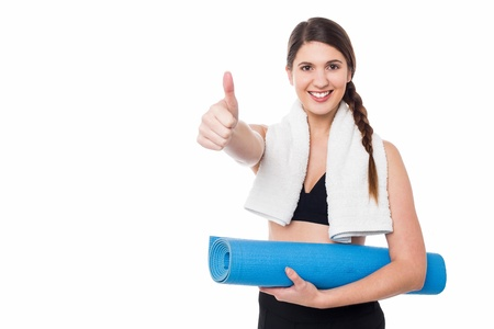 Smiling female trainer gesturing thumbs up photo