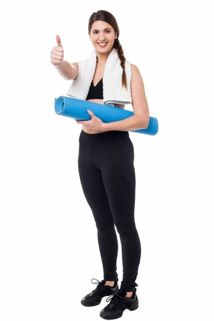 Fit lady with success gesture after her workout photo