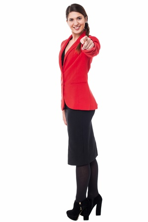 Confident stylish business lady pointing you out photo