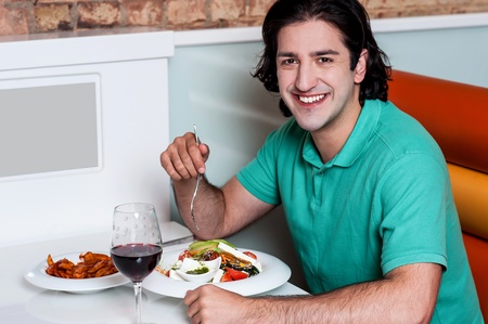 relishing: Casual smart guy relishing his day meal Stock Photo