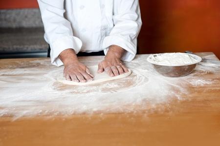 pizza base: Baker preparing pizza base
