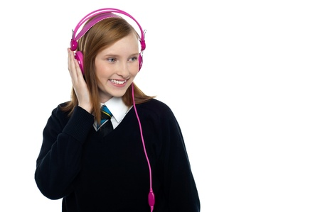 Student listening to music through headphones photo