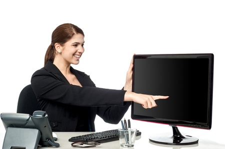 Woman pointing at something over lcd screen photo