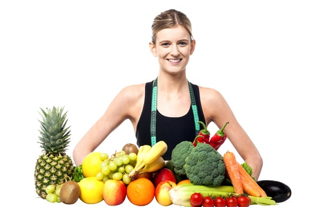 dietitian: Female nutrition expert with fruits and vegetables Stock Photo