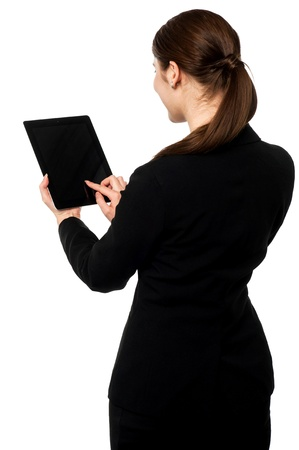 back screen: Corporate lady browsing on her tablet pc Stock Photo