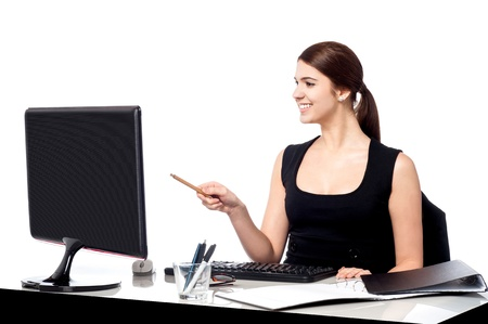 Personal assistant pointing at computer screen photo