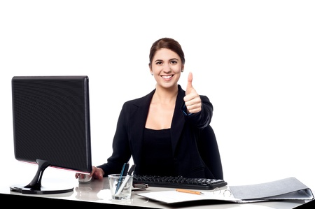 yup: Female executive showing thumbs up sign Stock Photo