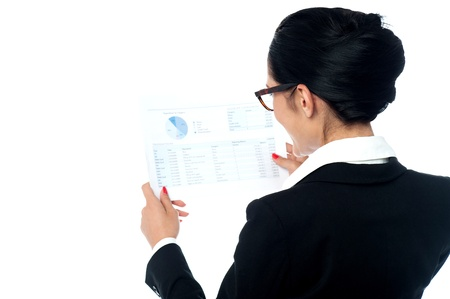 Corporate lady cross checking sales report photo