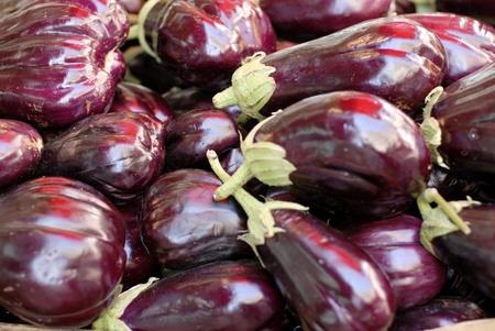 elongated: Eggplants at a market stall, closeup shot